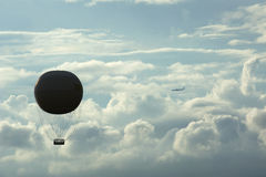 Hot air balloon and jet Royalty Free Stock Image