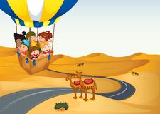 The hot air balloon with kids at the desert. Illustration of the hot air balloon with kids at the desert Stock Photography