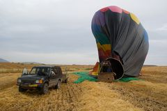 Hot air balloon landing Stock Photo