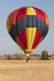 Hot air balloon landing Stock Photography
