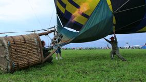 Hot air balloon last seconds before takeoff. Pilots heating the air. Stock footage stock video footage