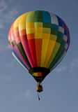 Hot air balloon launching against a blue sky Royalty Free Stock Image