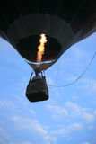 Hot Air Balloon lifting off in the evening stock image