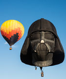 Darth Vadar Hot Air Balloon Liftoff. Lift off of multiple hot air balloons in the evening sky at the 2015 New Jersey Festival of Ballooning. The festival is held Royalty Free Stock Photography