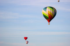 Hot air balloon moving up in blue sky. Stock Images