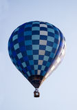 Hot air balloon moving up in blue sky. Royalty Free Stock Photos