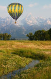Hot Air Balloon Near the Mountains Royalty Free Stock Photo