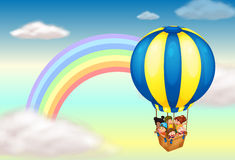 A hot air balloon near the rainbow Stock Image