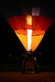 Hot air balloon by night. Taking off stock images