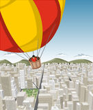 Hot air balloon over big city. With buildings. Downtown Stock Photo