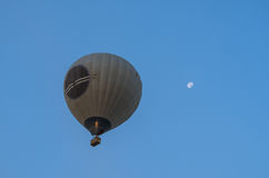 Hot Air Balloon over blue sky and moon. Royalty Free Stock Photography