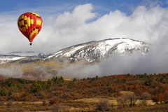 Hot Air Balloon over Cloudy Colorado Landscape Stock Image