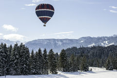 Hot air balloon over cross-country skiing Stock Photography