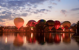 Hot Air Balloon over evening summer lake Royalty Free Stock Photo