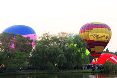 Hot Air Balloon over evening summer lake Royalty Free Stock Photography