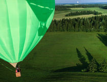 Hot air balloon over the field with blue sky Royalty Free Stock Image
