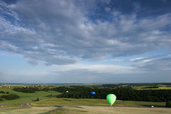 Hot air balloon over the field with blue sky Stock Photography