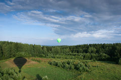 Hot air balloon over the field with blue sky Royalty Free Stock Photos