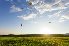 Hot air balloon over the field. With blue sky Royalty Free Stock Photo