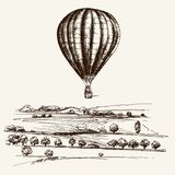 Hot air balloon over the field. Hand drawn illustration Stock Images