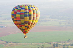 Hot air balloon over fields Royalty Free Stock Images