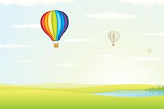 Hot Air Balloon over Green Fields. Vector Image Stock Photos