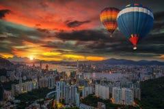 Hot air Balloon over Hong kong sky Stock Photos