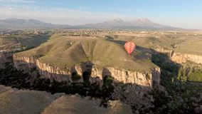Hot air balloon over Ihlara Valley. A hot air balloon over the Ihlara Valley in Turkey Royalty Free Stock Photography