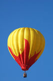 Hot air balloon over Iowa. A hot air balloon in flight over Iowa during a balloon festival royalty free stock photo