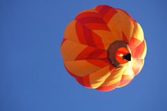 Hot air balloon over Iowa. A hot air balloon in flight over Iowa during a balloon festival royalty free stock photos