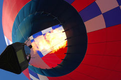Hot air balloon over Iowa. A hot air balloon in flight over Iowa during a balloon festival royalty free stock image