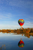 Hot Air Balloon Over Lake Stock Photography