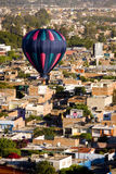 Hot air balloon over Leon Mexico. Hot air balloon flies over urban area of Leon Mexico Royalty Free Stock Photos