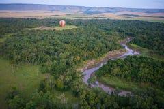 Hot air balloon over Masai Mara. Hot air balloon over the Masai Mara National Reserve, Kenya, Africa Royalty Free Stock Photos