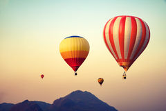 Hot air balloon over mountain on sky sunset. Vintage and retro filter effect style Royalty Free Stock Image