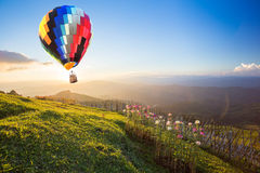Hot air balloon over the mountain. At sunset Stock Photo