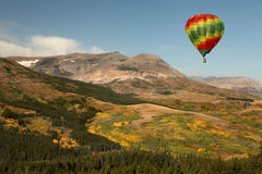 A Hot Air Balloon Over a Mountainous Fall Landscap Stock Image