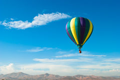 Hot Air Balloon over mountains Stock Image