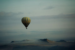 Hot Air Balloon Over Mountains. Hot Air Balloon over Cappadocia, Turkey royalty free stock images