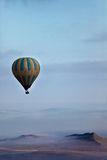 Hot Air Balloon Over Mountains Stock Images