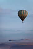 Hot Air Balloon Over Mountains. Hot Air Balloon over Cappadocia, Turkey royalty free stock photo