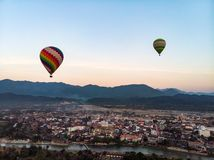 Hot air balloon over Nam Song river at sunset in Vang vieng. Laos. aerial view, top view stock image