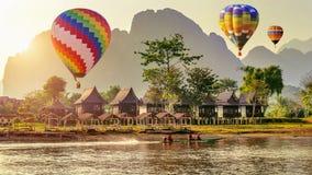 Hot air balloon over Nam Song river at sunset in Vang vieng, Laos.  royalty free stock photography