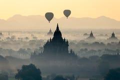 Hot air balloon over pagodas at Bagan, Myanmar Stock Images
