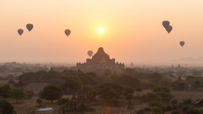 Hot air balloon over plain of Bagan in misty morning, Myanmar Stock Images