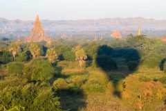 Hot air balloon over plain of Bagan in misty morning, Myanmar stock photos
