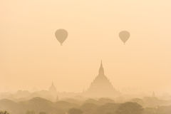 Hot air balloon over plain of Bagan in misty morning before sunrise, Myanmar stock photography