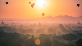 Hot air balloon over plain and pagoda of Bagan in misty morning. Myanmar Royalty Free Stock Photography