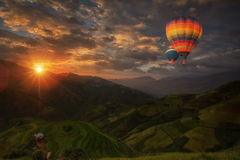 Hot air balloon over Rice fields on terraced Stock Photography