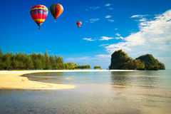 Hot air balloon over the sea Stock Images